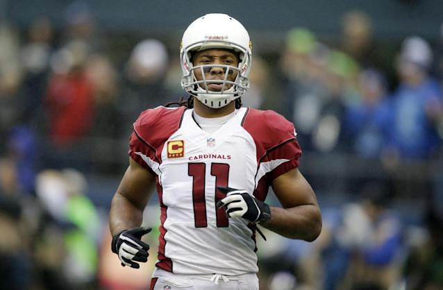 Arizona Cardinals wide receiver Larry Fitzgerald (11) reacts to a play in the first half of an NFL football game against the Seattle Seahawks, Sunday, Dec. 22, 2013, in Seattle. (AP Photo/Stephen Brashear)