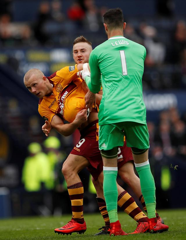 Soccer Football - Scottish Cup Semi-Final - Motherwell vs Aberdeen - Hampden Park, Glasgow, Britain - April 14, 2018 Motherwell's Curtis Main celebrates with Allan Campbell after scoring their third goal as Aberdeen's Joe Lewis tries to retrieve the ball Action Images via Reuters/Lee Smith