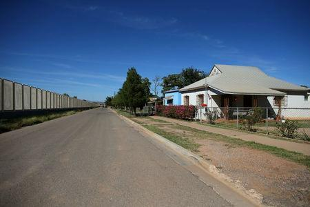Residential homes are seen next to the fence that borders Mexico, in Douglas, Arizona, United States, October 10, 2016. REUTERS/Mike Blake