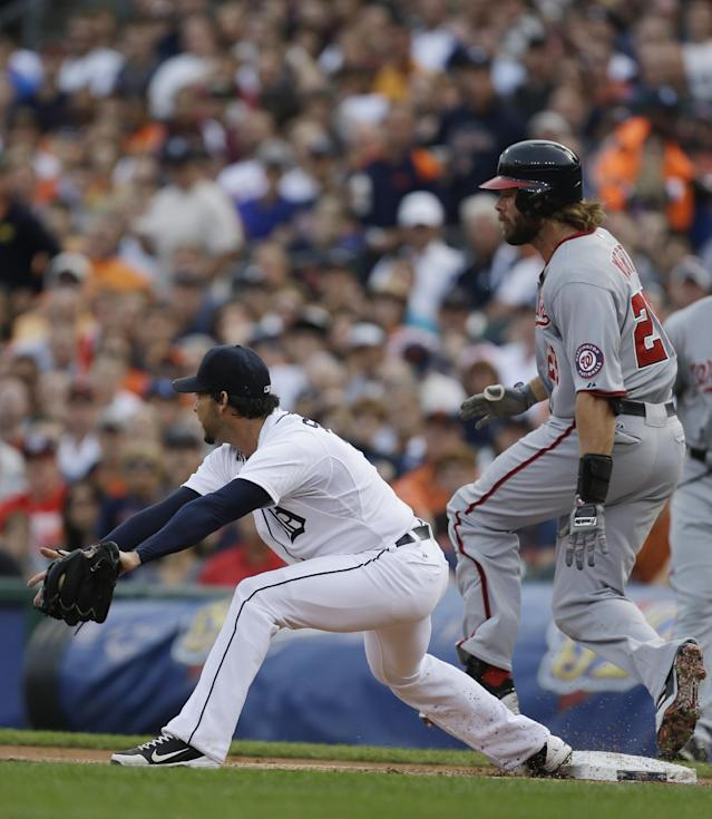 Washington Nationals' Jayson Werth beats the throw from Detroit first baseman Prince Fielder to pitcher Anibal Sanchez during the first inning of a baseball game in Detroit, Tuesday, July 30, 2013. (AP Photo/Carlos Osorio)