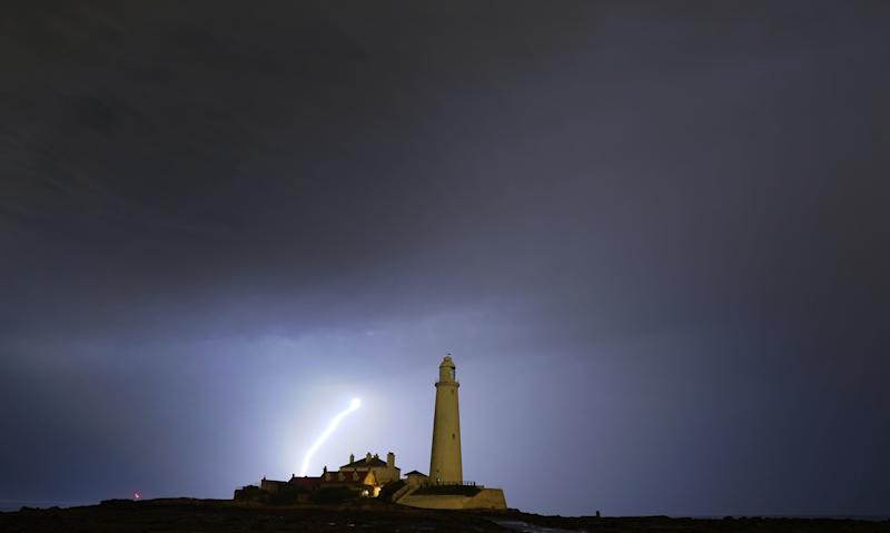 Lightning near St Mary's lighthouse in Whitley Bay, north east England. PRESS ASSOCIATION Photo. Picture date: Saturday July 27, 2019. The Met Office has issued a yellow weather warning for rain which covers vast swathes of Scotland and England, with the exception of the South West region, until Sunday afternoon. See PA story WEATHER Hot . Photo credit should read: Owen Humphreys/PA Wire