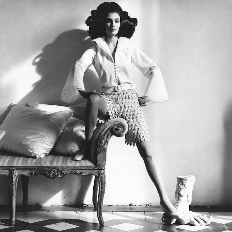 """Benedetta Barzini in """"leaves and layers from Mila Schön—the leaves of silvery threads covering, with a twinkle, short pants. The blouse, three layers of white organza in step-back edges at the deep pointed collar and flared sleeves."""""""