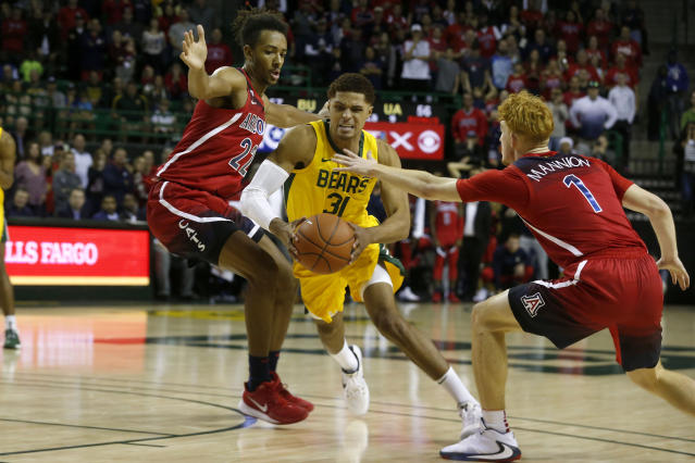 Baylor guard MaCio Teague (31) drives past Arizona forward Zeke Nnaji (22) and Arizona guard Nico Mannion (1) during the second half of an NCAA college basketball game in Waco, Texas, Saturday, Dec. 7, 2019. (AP Photo/Michael Ainsworth)