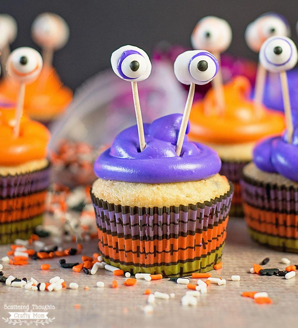 """<p>Your kids will have a scary good time assembling—and eating!—these candy-eyed monsters.</p><p><strong>Get the recipe at <a href=""""https://www.scatteredthoughtsofacraftymom.com/easy-monster-cupcakes-halloween/"""" rel=""""nofollow noopener"""" target=""""_blank"""" data-ylk=""""slk:Scattered Thoughts of a Crafty Mom"""" class=""""link rapid-noclick-resp"""">Scattered Thoughts of a Crafty Mom</a>.</strong></p><p><a class=""""link rapid-noclick-resp"""" href=""""https://www.amazon.com/Makerstep-Quality-Cocktail-Toothpicks-Everyday/dp/B0765QS1MQ?tag=syn-yahoo-20&ascsubtag=%5Bartid%7C10050.g.1366%5Bsrc%7Cyahoo-us"""" rel=""""nofollow noopener"""" target=""""_blank"""" data-ylk=""""slk:SHOP TOOTHPICKS"""">SHOP TOOTHPICKS</a></p>"""