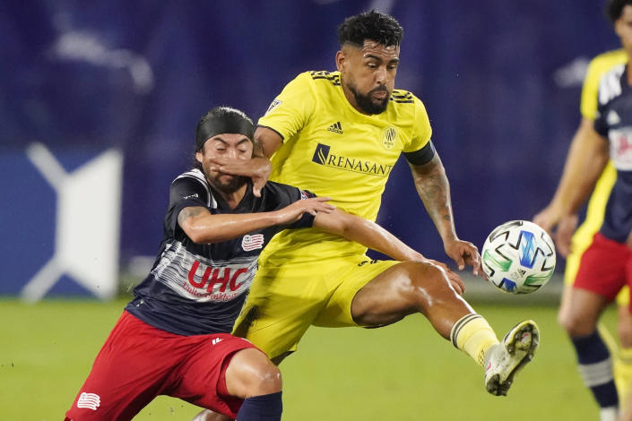 New England Revolution midfielder Lee Nguyen, left, and Nashville SC midfielder Anibal Godoy fight for the ball during the first half of an MLS soccer match Friday, Oct. 23, 2020, in Nashville, Tenn. (AP Photo/Mark Humphrey)