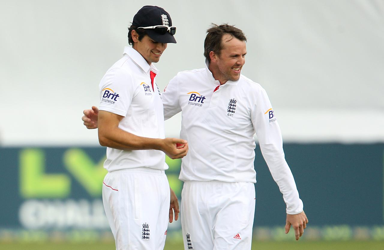 England's Alastair Cook (left) and Graeme Swann celebrate a wicket during day four of the International Tour match at The County Ground, Chelmsford.