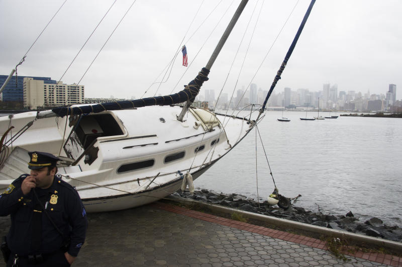 A boat rests on the waterfront of the Hudson River in Hoboken, N.J. across from New York City, background right, on Tuesday, Oct. 30, 2012 after superstorm Sandy made landfall in New Jersey Monday evening. (AP Photo/Charles Sykes)