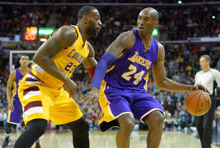 FILE PHOTO: Feb 10, 2016; Cleveland, OH, USA; Cleveland Cavaliers forward LeBron James (23) defends Los Angeles Lakers forward Kobe Bryant (24) in the first quarter at Quicken Loans Arena. Mandatory Credit: David Richard-USA TODAY Sports/File