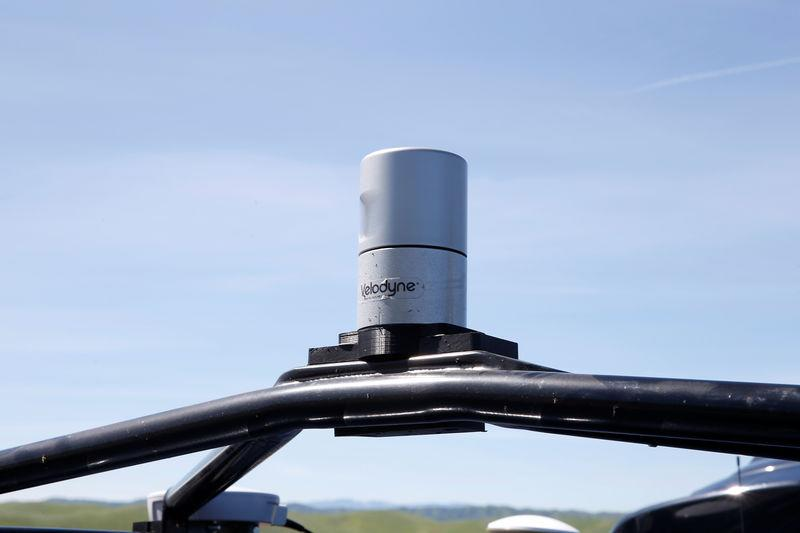 FILE PHOTO: A Velodyne LiDAR sensor is seen mounted on a self-driving vehicle during a self-racing cars event at Thunderhill Raceway in Willows, California