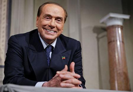 Italy's Berlusconi resists pressure, for now, to stand aside