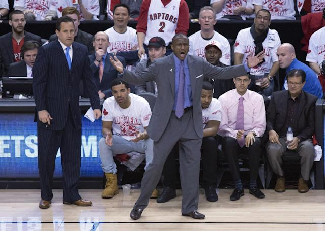 Toronto Raptors coach Dwane Casey gestures at a referee as musician Drake, lower center left, watches during the first half of Game 1 of an opening-round NBA basketball playoff series, in Toronto on Saturday, April 19, 2014. (AP Photo/The Canadian Press, Darren Calabrese)