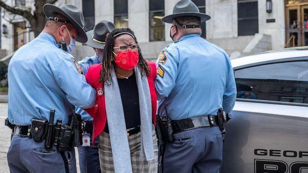 PHOTO: State Rep. Park Cannon is placed into the back of a Georgia State Capitol patrol car after being arrested by Georgia State Troopers at the Georgia State Capitol Building in Atlanta, March 25, 2021. (Alyssa Pointer/AP)