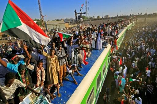 Sudanese celebrated as a train arrived from Khartoum to Atbara