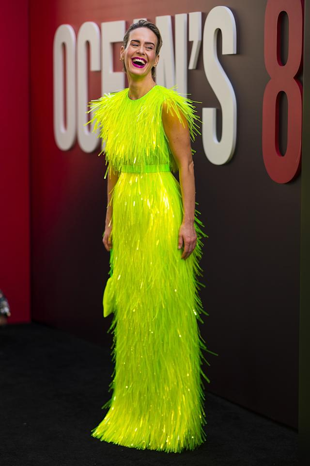 <p>Sarah Paulson brought some colour to the carpet wearing a bright green Prada dress with green sequin fringes. Source: Getty </p>