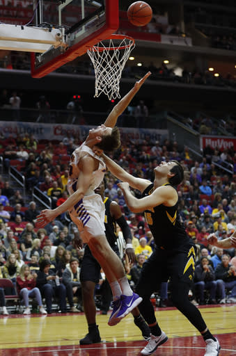 Northern Iowa forward Luke McDonnell, tries to pull down a rebound as Iowa forward Ryan Kriener, right, fouls him during the first half of an NCAA college basketball game, Saturday, Dec. 15, 2018, in Des Moines. (AP Photo/Matthew Putney)
