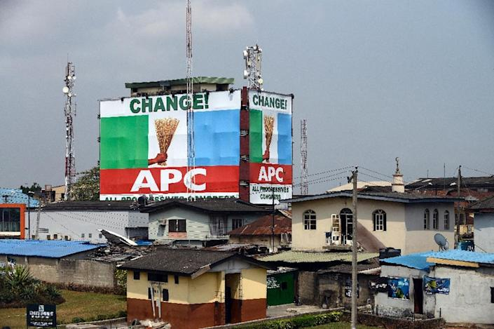 A campaign poster for the All Progressives Congress, the political party of Aisha Jummai Alhassan and incoming president Muhammadu Buhari, in Lagos on February 5, 2015 (AFP Photo/Pius Utomi Ekpei)