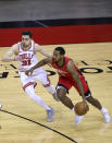 Houston Rockets' Sterling Brown, right, drives against Chicago Bulls' Tomas Satoransky (31) during the first quarter of an NBA basketball game Monday, Feb. 22, 2021, in Houston. (Carmen Mandato/Pool Photo via AP)