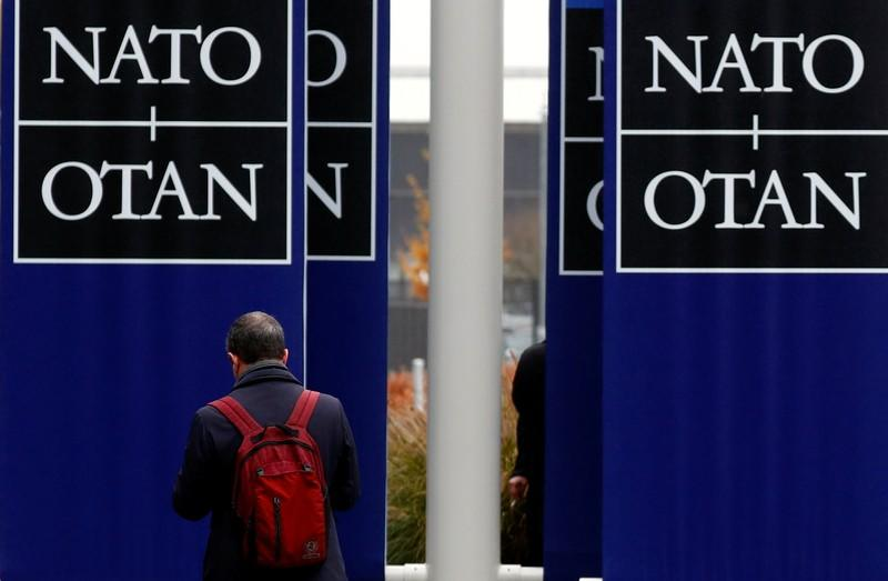 A man leaves NATO headquarters in Brussels
