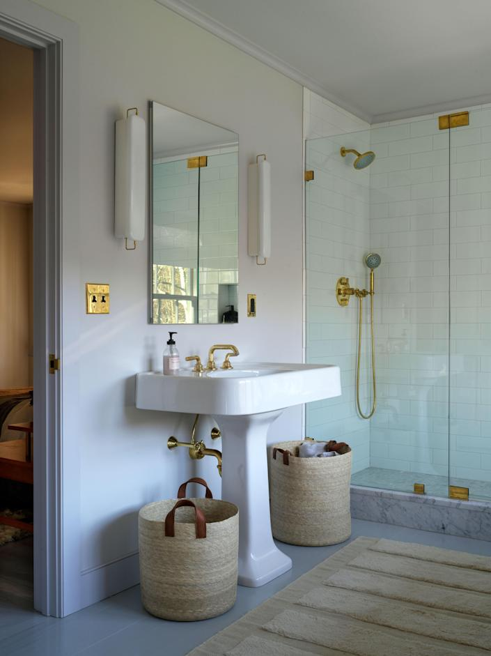 Workstead sconces flank the couple's vanity.