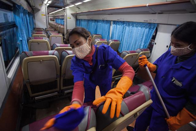 A railway worker is pictured cleaning a train at Bangkok railway station on 4 March. Thailand has 43 confirmed cases. (Getty Images)
