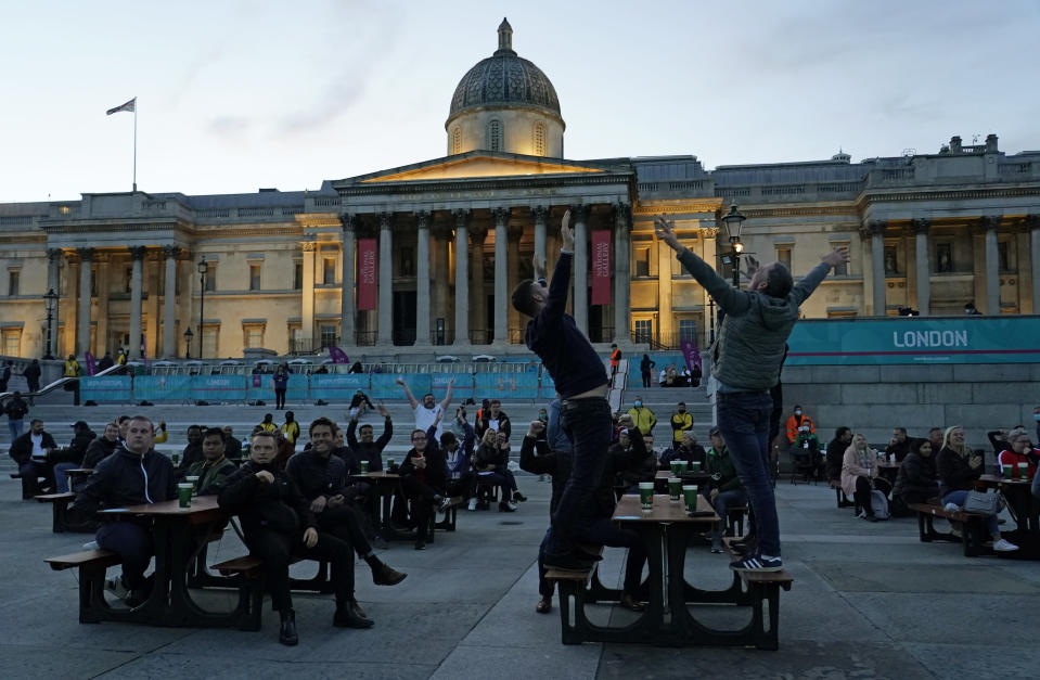 England supporters react after a goal was scored that was later disallowed in the fan zone in Trafalgar Square in London, Tuesday, June 22, 2021 during the Euro 2020 soccer championship group D match between England and the Czech Republic at Wembley Stadium. (AP Photo/Alberto Pezzali)