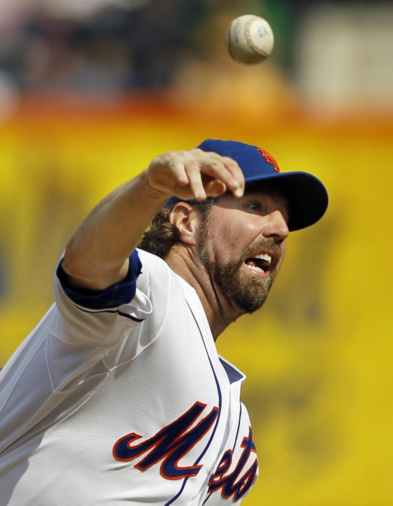 FILE - In this Sept. 27, 2012, file photo, New York Mets starting pitcher R.A. Dickey delivers against the Pittsburgh Pirates during the first inning of a baseball game at Citi Field in New York. Dickey and Mets general manager Sandy Alderson can agree on one thing _ they would prefer to have closure before opening day.  The Cy Young Award winner can become a free agent after the 2013 season and says he won't negotiate once it starts, so the Mets probably have to sign him to an extension or trade him to get the best return.  (AP Photo/Kathy Willens, File)
