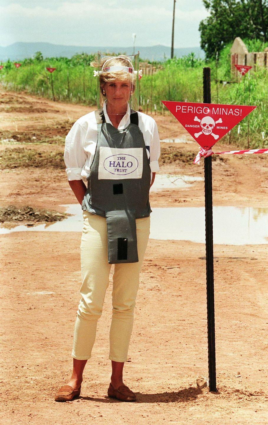 """<p>It wasn't the outfit that caused controversy in Angola, but rather the body armor Princess Diana wore to demonstrate the dangerous landmines across the nation's countryside. Although the princess' work with The Halo Trust is now praised, at the time many <a href=""""https://www.townandcountrymag.com/society/tradition/a12021518/princess-diana-landmines/"""" rel=""""nofollow noopener"""" target=""""_blank"""" data-ylk=""""slk:criticized her for taking a political stance"""" class=""""link rapid-noclick-resp"""">criticized her for taking a political stance</a> as a royal. </p>"""