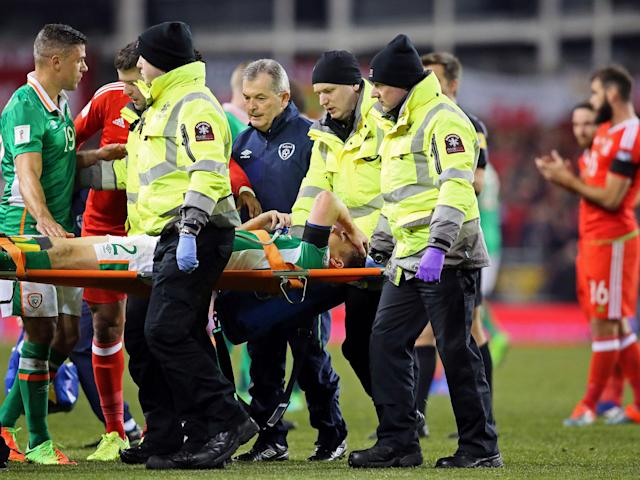 Coleman received oxygen following Taylor's challenge before being stretchered off: Getty