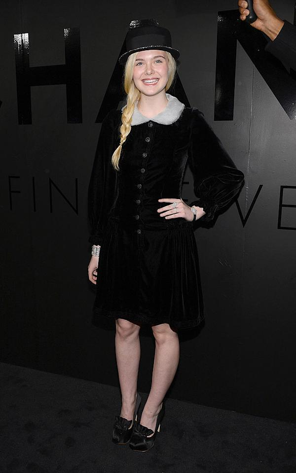 "<p class=""MsoNormal"">One of young Hollywood's most stylish stars, Elle Fanning, looked ready for Thanksgiving – or a stage production of ""Little Lord Fauntleroy"" – thanks to her velvet Pilgrim-like frock featuring a Peter Pan collar, satin ruffled shoes, and glitter-trimmed bowler hat. (10/9/2012)</p>"