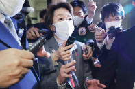 """Japan's Olympics Minister Seiko Hashimoto, center, is surrounded by reporters at the Lower House in Tokyo, Wednesday, Feb. 17, 2021. Japan's Kyodo news agency, citing a source """"familiar with the matter,"""" said Wednesday, a selection committee will ask Hashimoto to become the new president of the Tokyo Olympic organizing committee. Hashimoto, who could be named this week, would replace Yoshiro Mori who was forced to resign last week after he made demeaning comments about women — basically saying they talk too much.(Meika Fujio/Kyodo News via AP)"""