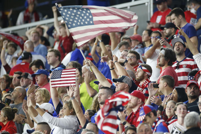 Fans celebrate after the United States defeated Costa Rica 2-1 in a World Cup qualifying soccer match Wednesday, Oct. 13, 2021, in Columbus, Ohio. (AP Photo/Jay LaPrete)