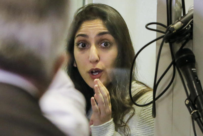 Israeli Naama Issachar gestures during an appeal hearings in a courtroom in Moscow, Russia, Thursday, Dec. 19, 2019. An Israeli backpacker serving prison time in Russia on a drug conviction is appealing her case and says she was wasn't provided a translator or lawyer after being detained at a Moscow airport. She was arrested in April in Moscow's Sheremetyevo Airport, where she was transferring flights en route from India to Israel. More than nine grams of hashish were found in her luggage. She was later sentenced to 7 1/2 years. (AP Photo/Alexander Zemlianichenko Jr.)