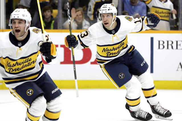 Nashville Predators center Nick Bonino (13) and right wing Rocco Grimaldi, left, celebrate after a goal by teammate Craig Smith against the St. Louis Blues in the second period of an NHL hockey game Sunday, Feb. 16, 2020, in Nashville, Tenn. (AP Photo/Mark Humphrey)