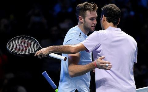 <span>Jack Sock congratulates Roger Federer on his win</span> <span>Credit: REUTERS </span>