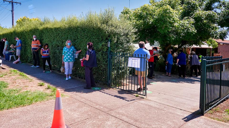 People, pictured here lining up as they wait to be tested for COVID-19 in Melbourne.