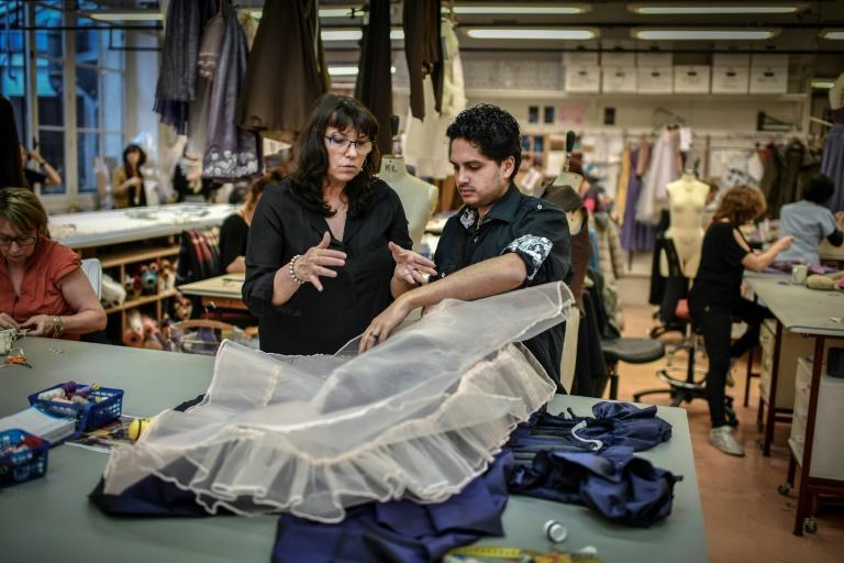 """Tutor and workshop head Anne-Marie Legrand, left, promises Tulio Morais that he will soon put together his first tutu for """"Swan Lake"""" in January"""