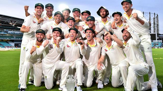 Tim Paine and the Aussies celebrate retaining the Ashes. (Photo by GLYN KIRK/AFP/Getty Images)