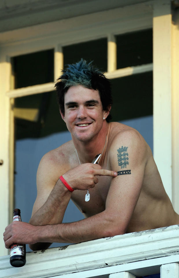 NOTTINGHAM, UNITED KINGDOM - AUGUST 28:  Kevin Pietersen of England points to his tattoo as he celebrates with a beer after winning the Fourth npower Ashes Test between England and Australia on August 28, 2005 played at Trent Bridge in Nottingham, United Kingdom.  (Photo by Tom Shaw/Getty Images)