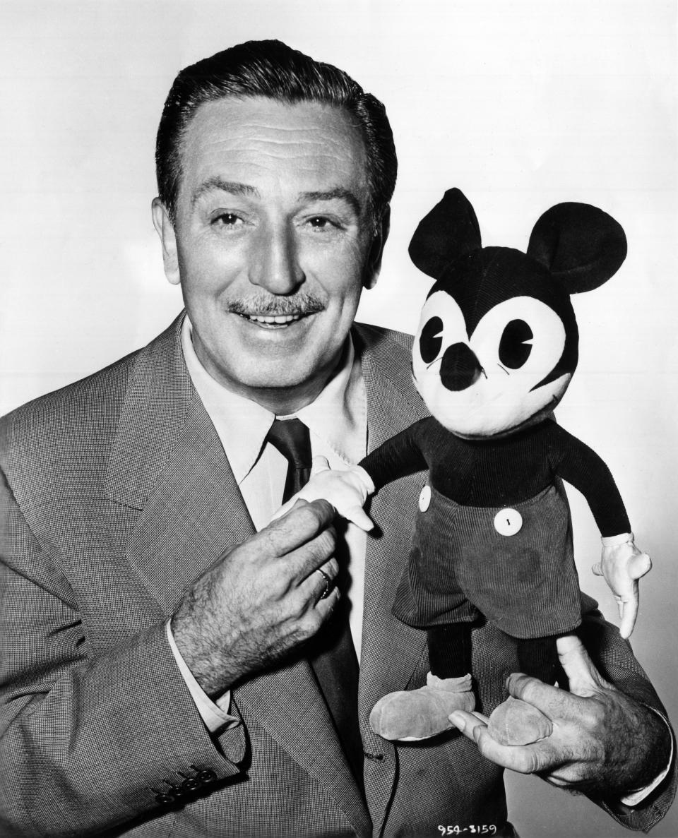 The American cartoonist and director Walt Disney with a plush puppet of Mickey Mouse. 1950s (Photo by Mondadori via Getty Images)