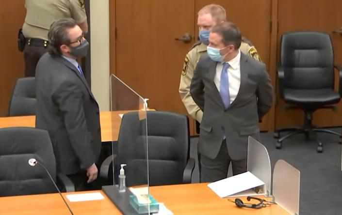 Defense attorney Eric Nelson (left) looks on as Derek Chauvin (right) is taken into custody Tuesday after the verdicts were read by the judge. (Photo: Hennepin County)