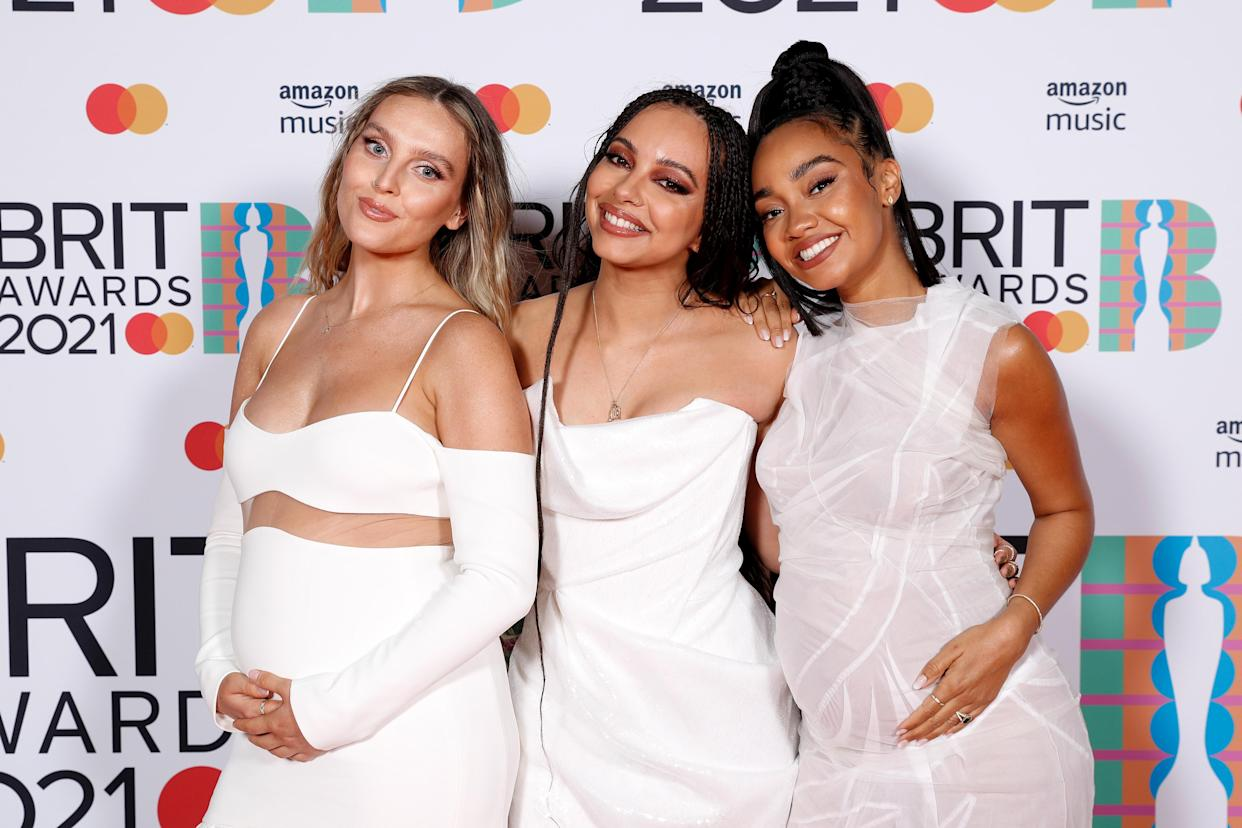 Jade Thirlwall (centre) says her Little Mix bandmates haven't been able to get much sleep since giving birth. (JMEnternational/BRIT Awards/Getty Images)