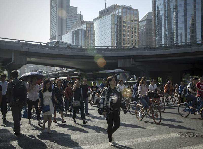 China's economy cools in May as Beijing's efforts to reduce debt levels start to bite