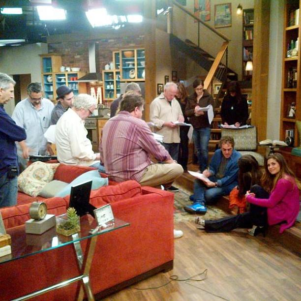 "In <a href=""http://instagram.com/p/XJFVDmm1mz/"">this photo</a>, the cast and crew go over the script on the set of what looks like the Matthews's living room."