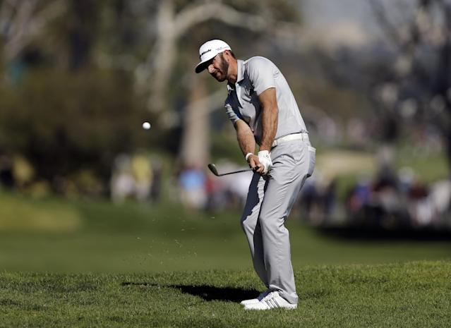 Dustin Johnson chips to the fourth green in the second round of the Northern Trust Open golf tournament at Riviera Country Club in the Pacific Palisades area of Los Angeles, Friday, Feb. 14, 2014. (AP Photo/Reed Saxon)