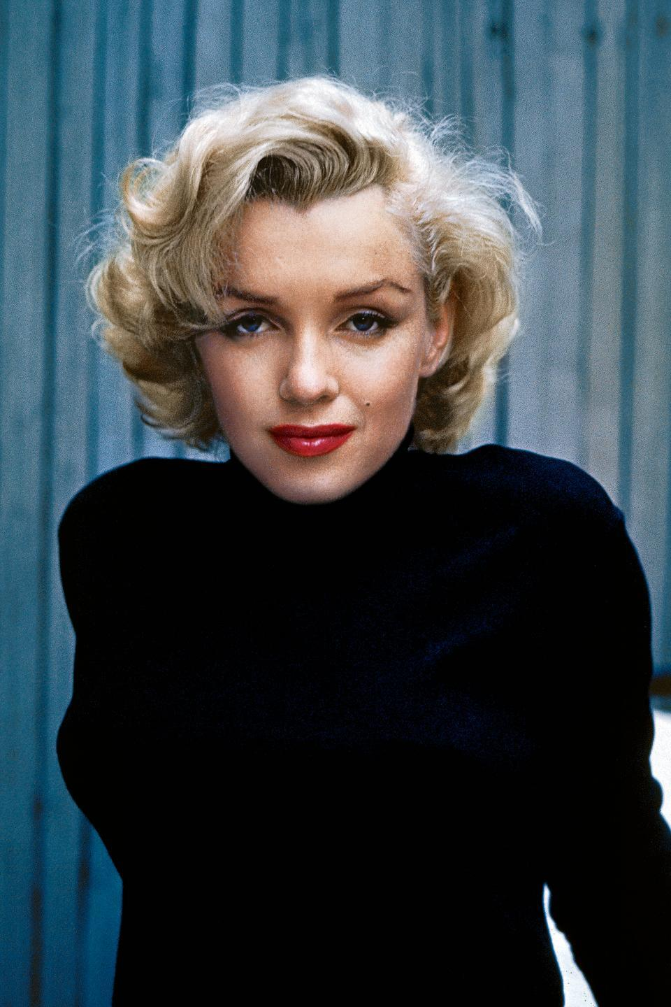 """<p><strong>Born</strong>: Norma Jeane Mortenson<strong><br></strong></p><p>Most probably know by now that the illustrious Marilyn Monroe grew up being called Norma Jeane (she was born to the last name Mortenson, baptized as Baker, and later married into Dougherty). But, do you know the story of how she became Marilyn?</p><p>According to <em><a href=""""https://time.com/5368339/marilyn-monroe-real-name-story/"""" rel=""""nofollow noopener"""" target=""""_blank"""" data-ylk=""""slk:Time"""" class=""""link rapid-noclick-resp"""">Time</a></em>, the actress ditched her first husband's surname because a 20th Century Fox studio executive thought that there would be too many interpretations of its pronunciation. Norma Jeane suggested the last name """"Monroe,"""" a name on her mother's side of the family, while the studio exec handed her """"Marilyn,"""" because she reminded him of 1920s Broadway starlet Marilyn Miller. </p>"""
