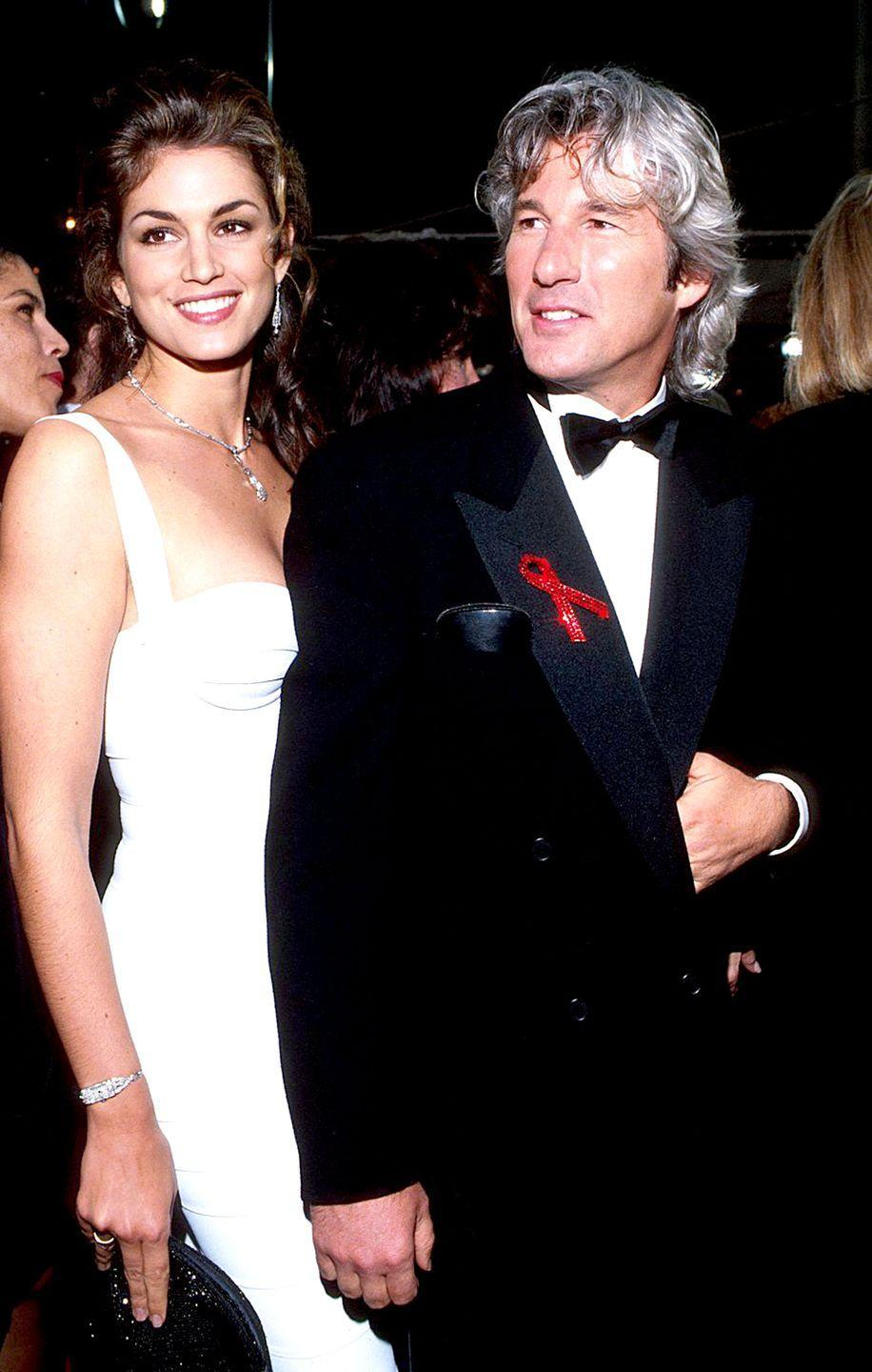 """<p>The couple met at a backyard BBQ at the home of their mutual friend, portrait photogrpaher Herb Ritts in 1988. Sure, Crawford was only 22-years-old when she met the 39-year-old <em>Pretty Woman</em> actor but love conquers all! The pair exchanged vows in December of 1991 at the Sin City chapel in Las Vegas, but would announce their divorce in 1995. </p><p>""""I think I was more willing at 22 to be, like, 'Okay, I'll follow,' but then you start going, 'Well, I don't want to just follow—I want to lead sometimes and I want to walk side by side sometimes,'"""" <a href=""""https://www.crfashionbook.com/celebrity/a23620918/cindy-crawford-richard-gere-wedding-vegas/#"""" rel=""""nofollow noopener"""" target=""""_blank"""" data-ylk=""""slk:she said"""" class=""""link rapid-noclick-resp"""">she said</a> on why they broke up.</p>"""