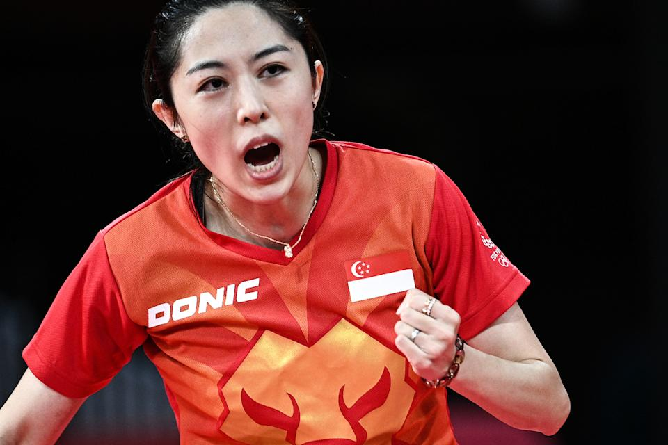 Singapore's Yu Mengyu celebrates a point against USA's Liu Juan during her women's singles round of 16 match at the 2020 Tokyo Olympics. (PHOTO: Anne-Christine Poujoulat/AFP)