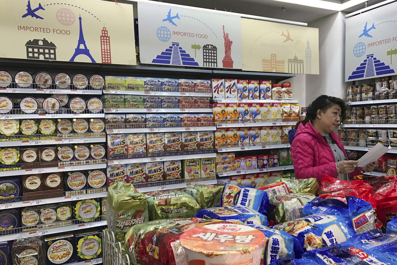 <p> FILE - In this March 17, 2017, file photo, a vendor takes stock of imported food at a mall in Beijing. China is cutting import tariffs on a range of consumer goods amid pressure from the United States, Europe and other governments for better access to its growing domestic market. (AP Photo/Ng Han Guan, File) </p>