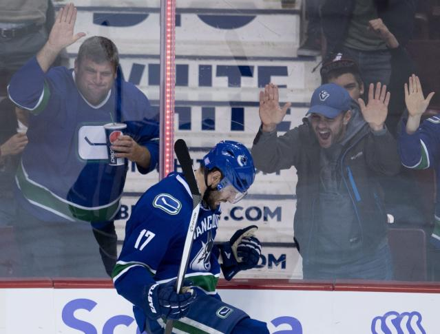 Vancouver Canucks center Ryan Kesler (17) celebrates his goal against the Washington Capitals during the third period of NHL hockey action in Vancouver, British Columbia on Monday, Oct. 28, 2013. (AP Photo/The Canadian Press, Jonathan Hayward)
