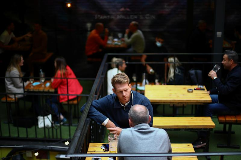 People sit in a pub in London Bridge, amid the outbreak of the coronavirus disease (COVID-19) in London, Britain, September 24, 2020. REUTERS/Hannah McKay